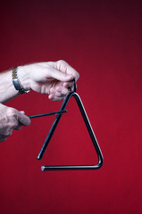 Triangle Played Isolated on Red
