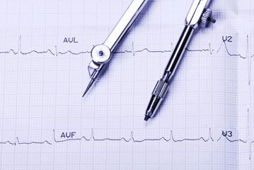 EKG printout and compasses