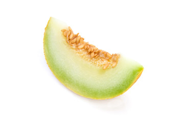 slice of yellow melon isolated on white background