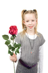 Young blonde girl gives red rose