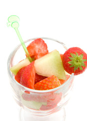 glass with fruits isolated on white background