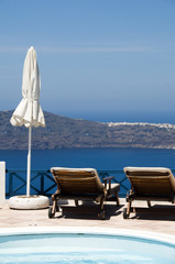 swimming pool view of volcanic island and mediterranean sea