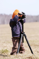 Young photographer with tripod