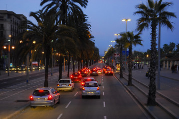 cars in the street at night in barcelona spain