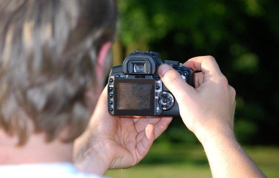 Photographe vue sur reflex numérique