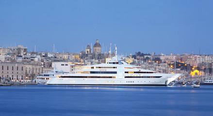 super yacht in a marina