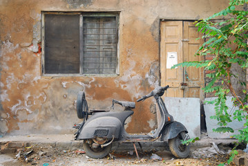 scooter and grunge wall in india