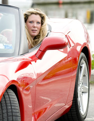 sexy woman in red sports car