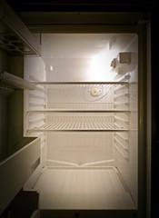 Empty fridge interior, frontal view