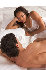Young couple Man and woman talking in bed