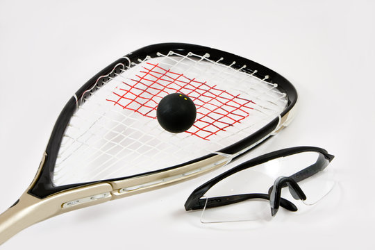 Squash racquet, ball and safety glasses