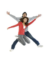 happy casual couple jumping of joy