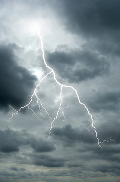 Lightening bolt flashes through a dramatic sky