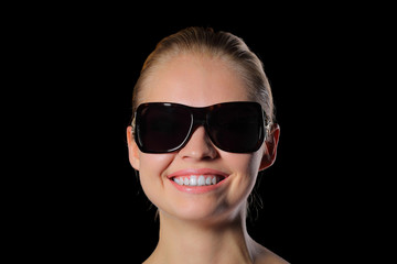Woman in sunglasses smiling