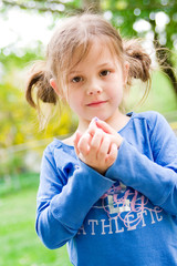 portrait of a little girl playing in the park