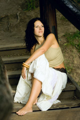 attractive woman on wooden stairs