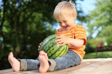 Happy boy with watermelon