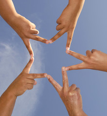 Hands together forming a star