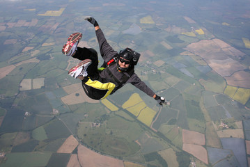 Skydiver falls through the air on his back