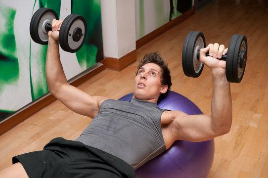 Dumbbell press on fitness ball