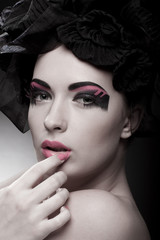 Closeup portrait of a beautiful young woman. Fashion art photo