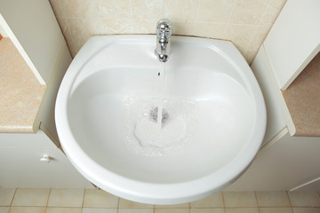 washbowl with water in the bathroom