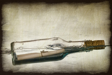 Grunge image of message in a bottle
