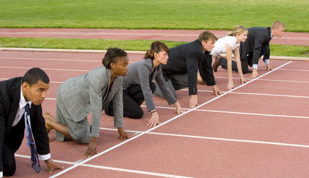 Business People Kneeling at the Starting Line
