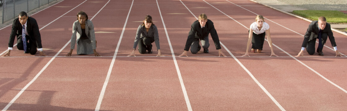 Business People Crouching at Starting Line