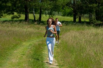 Woman with headphones jogging