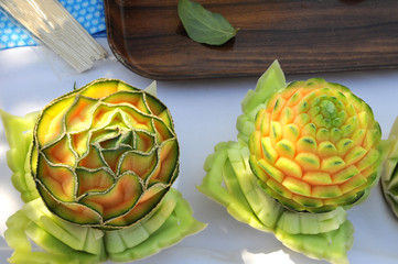 Carved Cantaloupes on a Table