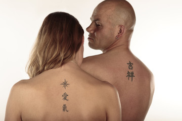 Man and woman with tattoos
