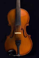 Beautiful antique violin over black