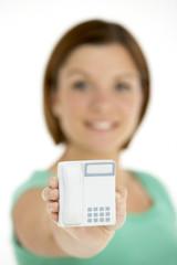 Woman Holding Model Telephone