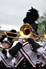 Marching Band Performer Playing Trombone in Parade