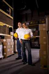 Two coworkers in office storage warehouse