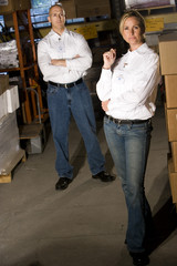 Two office coworkers in storage warehouse
