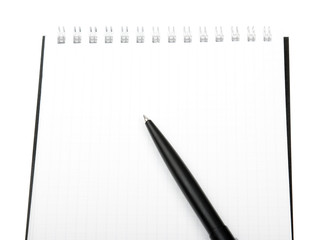 Close-up notebook and pencil isolated on white
