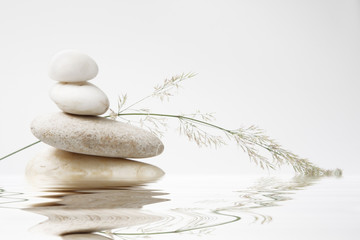 Obraz wellness still life, pebbles stacked with blade of grass - fototapety do salonu