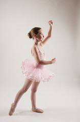 7 year old girl practicing ballet in tutu  MR