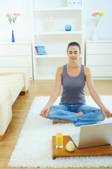 Woman using meditating at home
