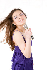 Lovely girl singing in microphone