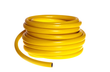 The yellow rubber garden hose on a white background (isolated).