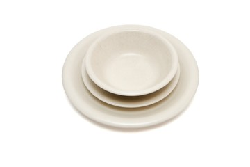 Plain beige dinner plate, soup plate and  saucer isolated