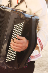 Playing button accordion. Keyboard and musician's hand