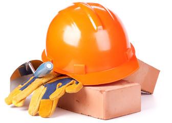 Building bricks, hard hat, trowel and gloves