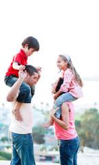 Parents giving their children piggyback rides