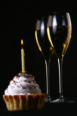 two elegant glasses with birthday cake