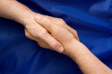 Hand shake against a blue background