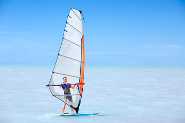 Young man on a windsurf